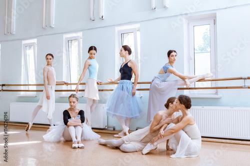 The seven ballerinas at ballet bar - 114226194
