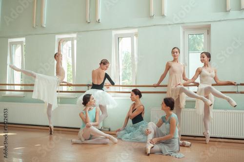 The seven ballerinas at ballet bar - 114226353