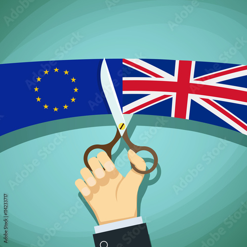 Human hand with scissors cuts the flags of Great Britain and the Fototapet