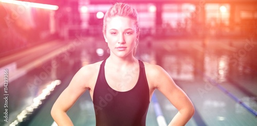 Fit woman with hands on hips Canvas Print