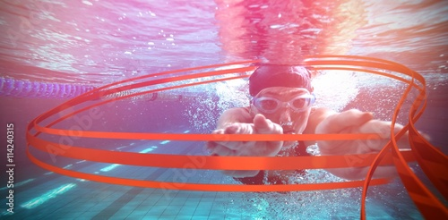 Photo  Composite image of athletic swimmer training on her own