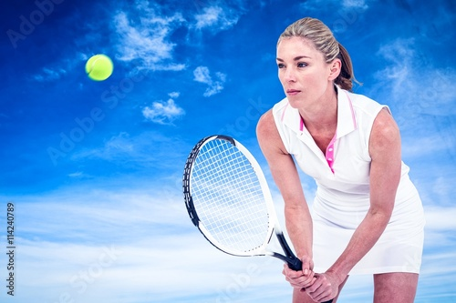 Photo  Composite image of athlete playing tennis with a racket