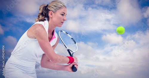Photographie  Composite image of athlete playing tennis with a racket