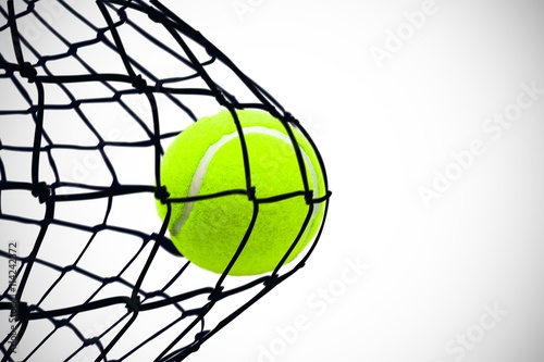 Composite image of tennis ball with a syringe Poster