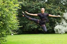 A Jazz Dancer Performing A Jump
