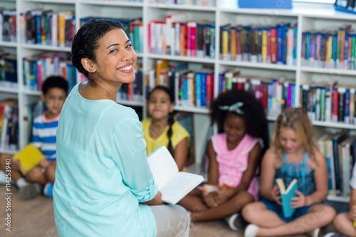 Obraz na płótnie Happy mixed race female teacher with children