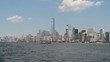 New York City skyline with boats from ferry.