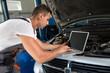 Mechanic using laptop