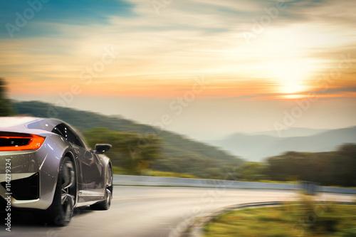 Brandless sport car drifting on the road under sunset. Canvas-taulu