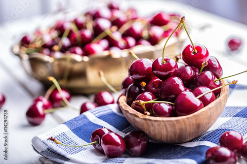 Foto auf Leinwand Kirschblüte Cherries. Sweet Cherries. Fresh Cherries. Ripe cherries on wooden concrete table - board.