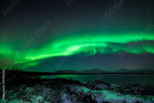 Photo  An aurora, sometimes referred to as a polar light, is a natural light display in the sky, predominantly seen in the high latitude (Arctic and Antarctic) regions