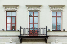Three Windows In A Row And Balcony On Facade Of Urban Apartment Building Front View, St. Petersburg, Russia.
