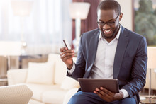 Man Holding Bank Card And Tablet