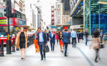 Business People Walk Through The City Of London Street. Blurred Image. City Of London Business Life Concept