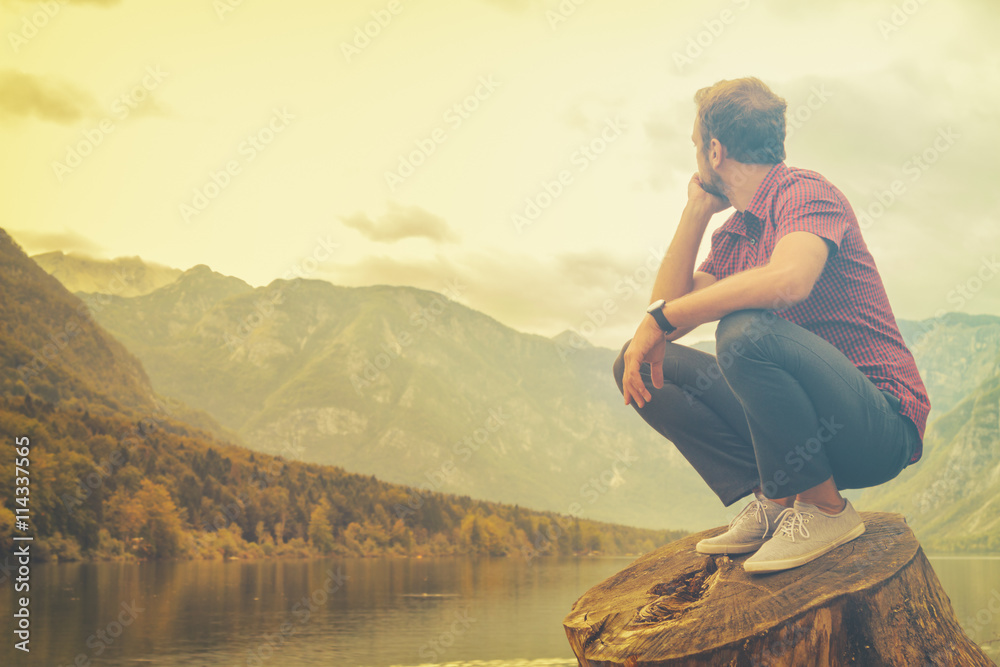 Fototapety, obrazy: Young man enjoying the freedom in nature.