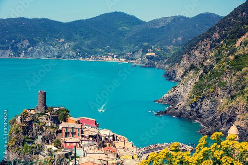 Poster Cappuccino Rocky sea coast. Ligurian sea, view at Vernazza Village, Cinqe Terre, Italy