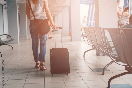 Fototapeta  Woman with her luggage