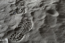 Close Up Boot Or Shoe Print, With Grip Set Deeply Into Dirty Sand, Left Side. Hdr Picture.