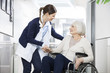 canvas print picture - Physiotherapist Consoling Senior Woman Sitting In Wheelchair