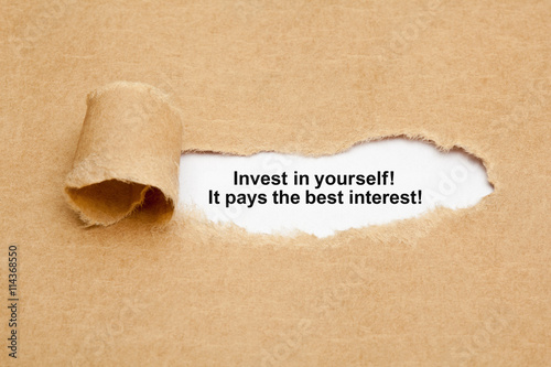 Fotografía  Invest In Yourself Quote Ripped Paper Concept