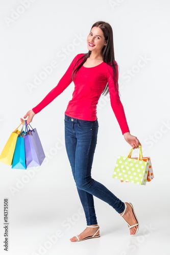 Cadres-photo bureau Avion, ballon Beautiful woman with a lot of shopping bags