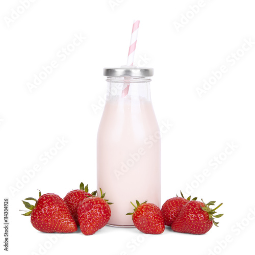 Foto op Plexiglas Milkshake Drinks and milk shakes - a strawberry milkshake in a vintage glass bottle with straw and fruit isolated on a white background