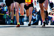 legs of runners at the marathon
