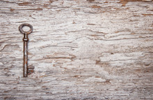 Vintage Background With Old Key On Weathered Wood