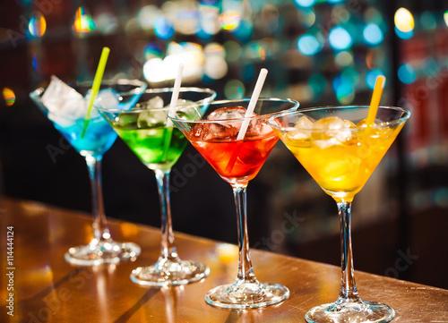 Obraz na plátně Multicolored cocktails at the bar.