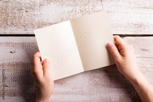 Unrecognizable woman holding empty greeting card studio shot buy unrecognizable woman holding empty greeting card studio shot m4hsunfo