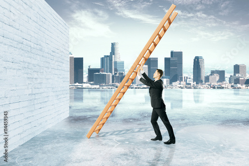 Fotografia  Obstacle overcoming with businessman