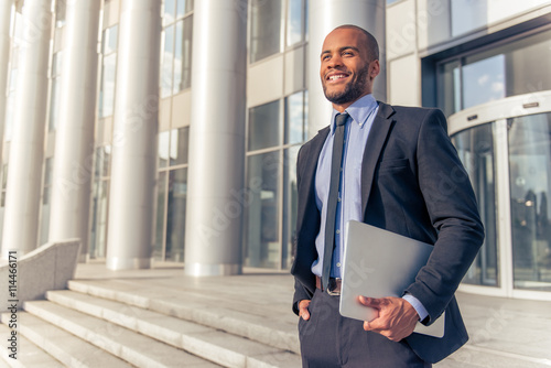 Photographie Afro American businessman with gadget