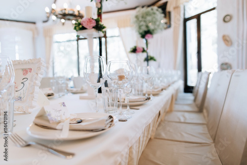 Elegant table arrangement and catering at wedding reception. Wedding ...