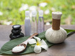 Spa massage compress balls, herbal ball on the leaves with rock spa, Thailand, select focus