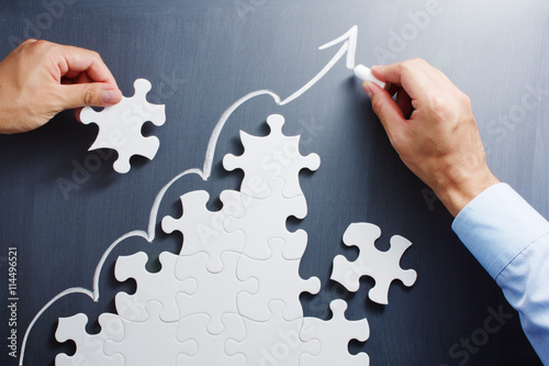 Fotografie, Obraz Working on steps shaped jigsaw puzzle