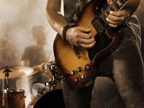 Valokuvatapetti Rock band performs on stage. Guitarist.