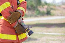Fireman Hand In Glove Hold Fir...