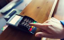 Hand Entering Password To Bank Terminal
