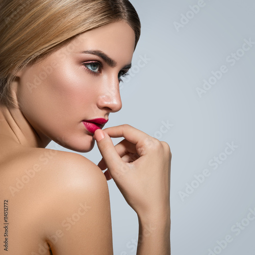 Fotografering  Beautiful blonde girl with red lips