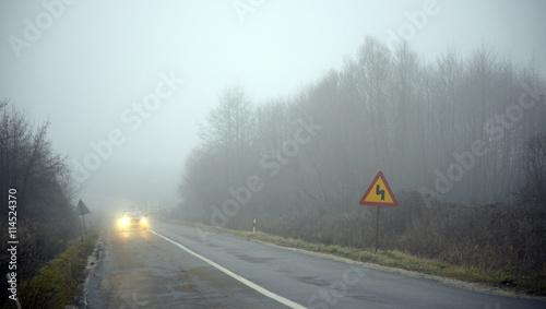 Fototapety, obrazy: Road and a car in fog
