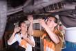 Mechanics repairing a broken car