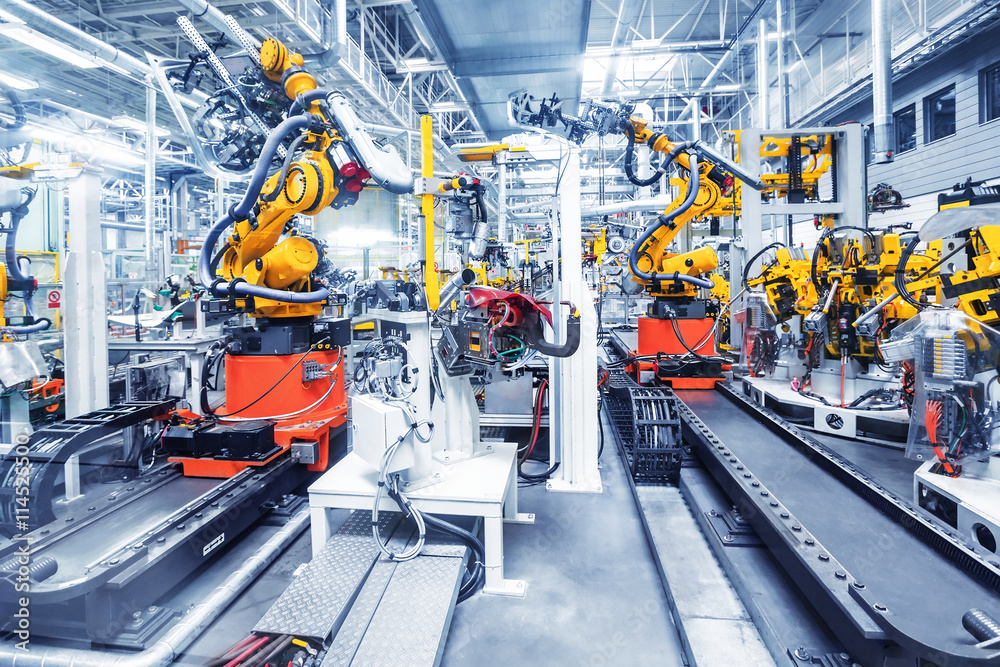 Fototapety, obrazy: robotic arms in a car plant