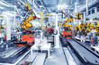 canvas print picture - robotic arms in a car plant
