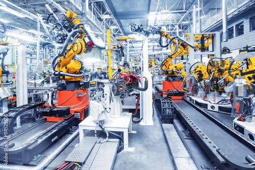 robotic arms in a car plant Canvas Print