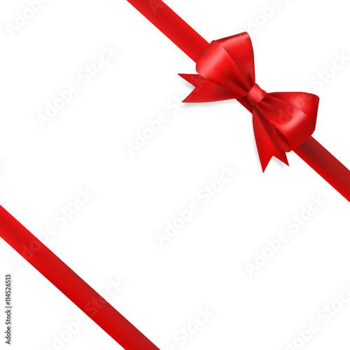 Fotografie, Obraz  red silky bow ribbon on white background. holidays gift symbol
