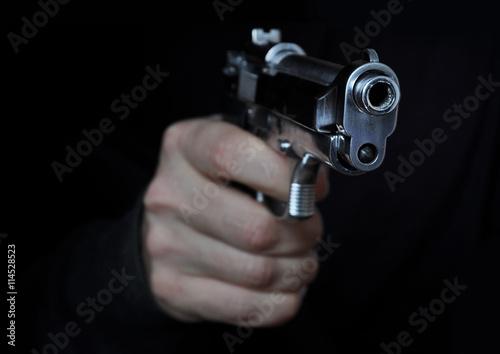 Man holding metal gun Wallpaper Mural