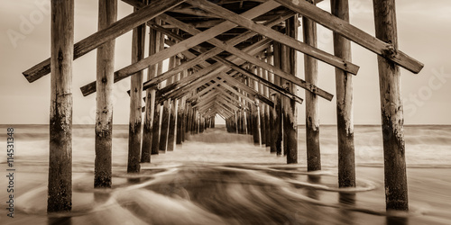 """Sepia Smooth""  The Ocean Isle Beach Pier is quiet in January. The Atlantic Coast of North Carolina is surreal and peaceful in the off season."