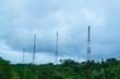 Telecommunications tower on the top of high mountain. Soft focus