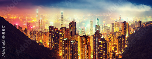 Keuken foto achterwand Hong-Kong Panoramic view oover Victoria Harbor in Hong Kong, China, by night. Colorful travel background with illuminated skyscrapers seen from Victoria Peak.