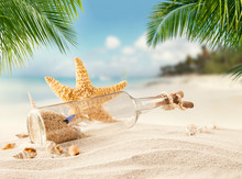 Sandy Tropical Beach With Bottle And Starfish